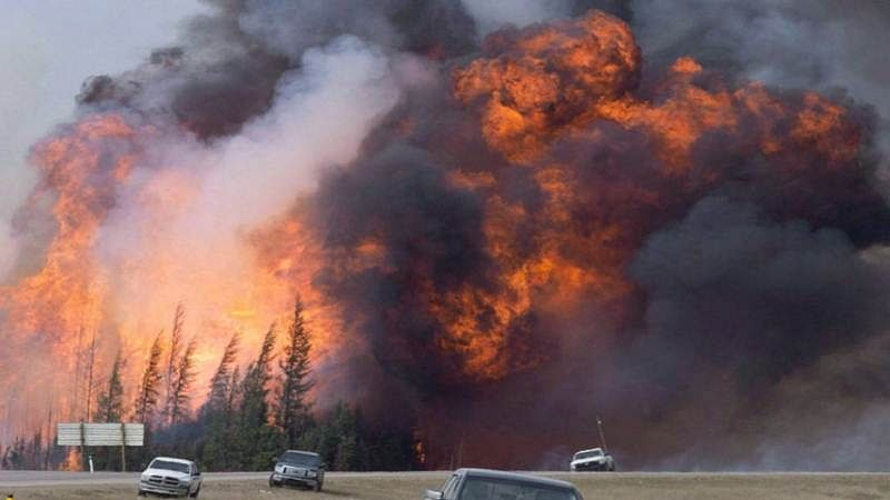 Massive wildfires sweep across Canadian province
