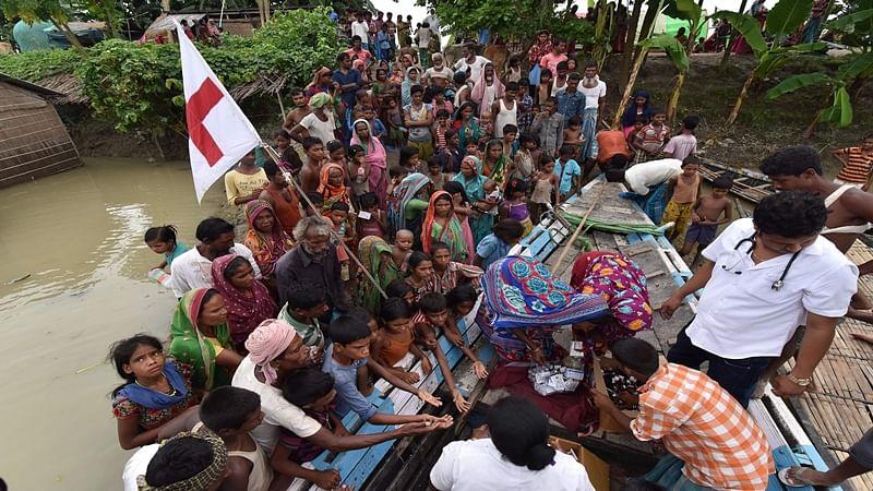 Assam floods: 13 people dead, 393 villages badly affected in Morigaon district