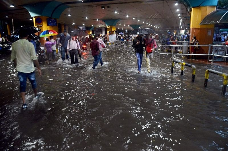 Mumbai rains: 108 Flights cancelled; Fliers grounded; 4 Washed away; 7 Swimmers missing