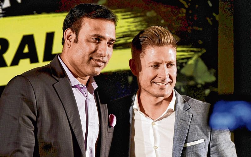 New Delhi : Former Indian cricketer VVS Laxman with former Australian cricketer Michael Clarke posing for a photo during a panel discussion on the upcoming India-Australia Series in New Delhi on Tuesday. PTI Photo by Shirish Shete(PTI9_12_2017_000152B)