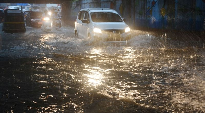 Mumbai Rains, Pictures: High tide, train delays; another tough day for Mumbaikars