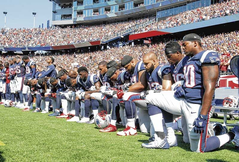 Wave of protests grip National Football League after Trump urges fan boycott