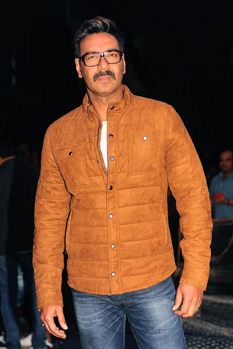 Indian Bollywood actor Ajay Devgn poses for a photograph during a promotional event for the 'Khatron Ke Khiladi' reality show, based on the US format 'Fear Factor' in Mumbai on late September 19, 2017. / AFP PHOTO / STR