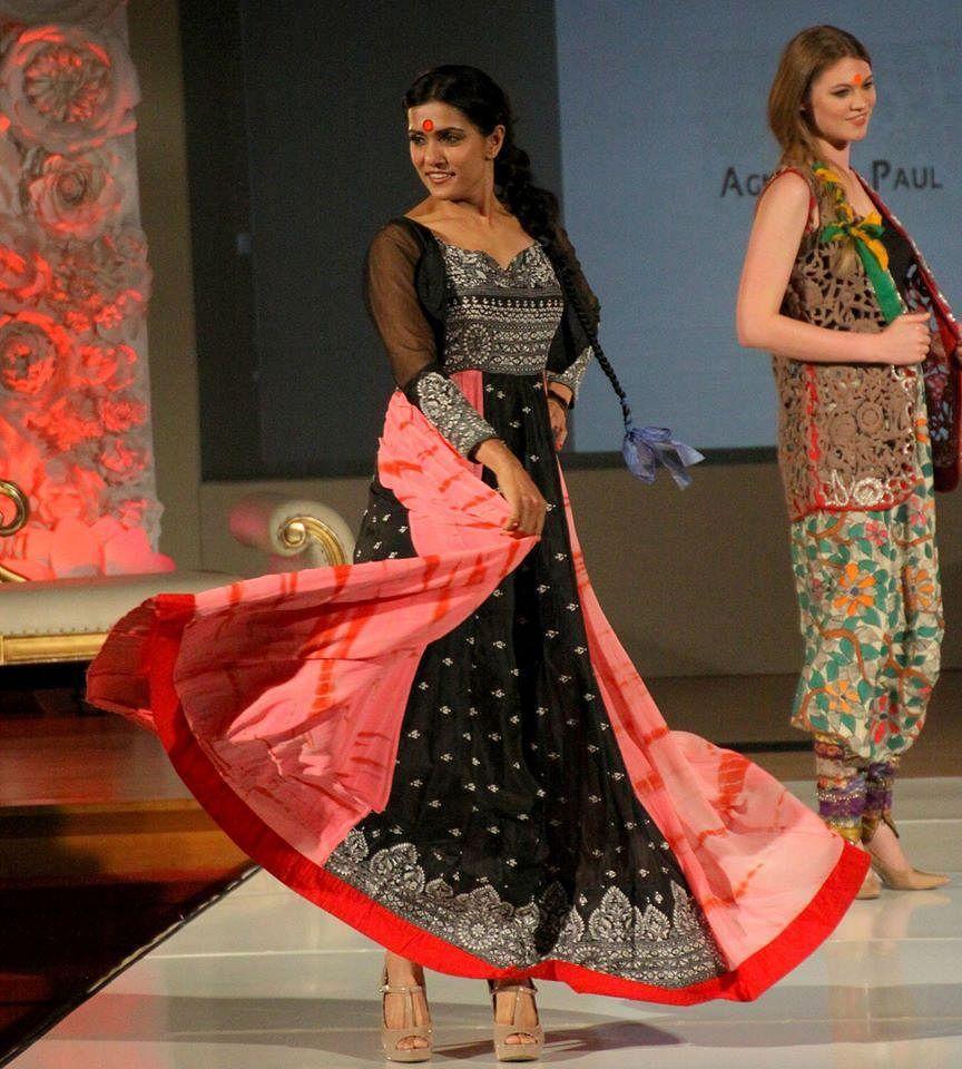 Models in Agnimitra Paul collection sporting big yellowish orange bindis during Lucknow Fashion Week