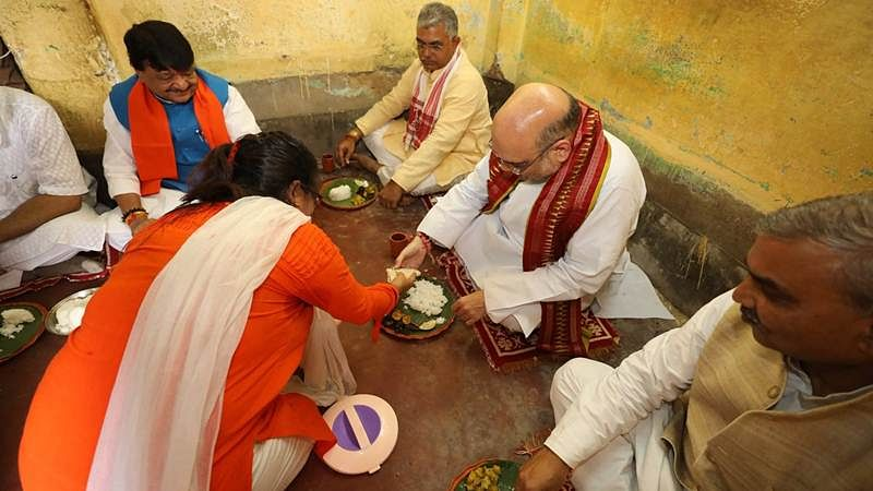 Amit Shah has rice, moong dal at BJP worker's house in Kolkata