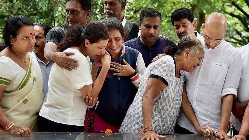 Bengaluru: Journalist Gauri Lankesh 's mother Indira, brother Indrajit Lankesh and sister Kavitha Lankesh grieve near the mortal ramains of her, in Bengaluru on Wednesday. PTI Photo by Shailendra Bhojak