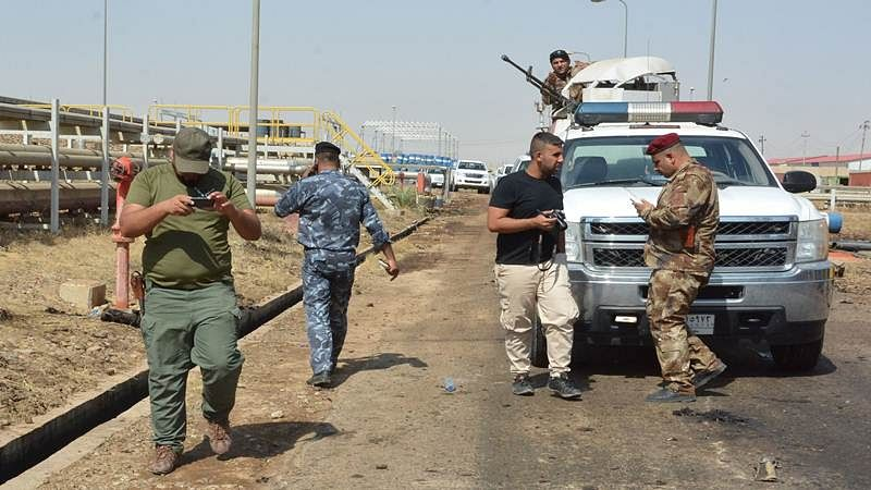 Suicide bombers armed with grenades kill 7 in Iraq, 12 injured
