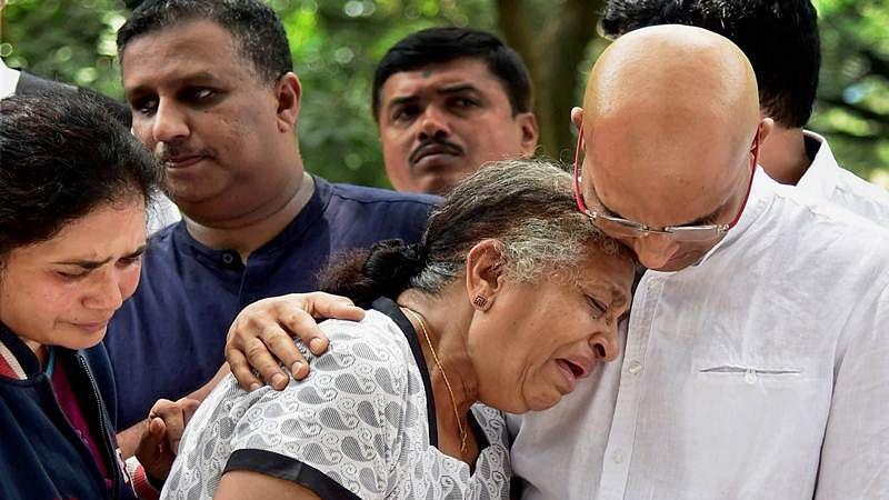 Bengaluru: Journalist Gauri Lankesh 's mother Indira and brother Indrajit Lankesh grieve near the mortal ramains of her, in Bengaluru on Wednesday. PTI Photo by Shailendra Bhojak