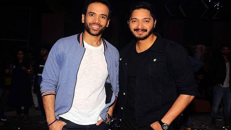 Indian Bollywood actors Tusshar Kapoor (L) and Shreyas Talpade pose for a photograph during a promotional event for the 'Khatron Ke Khiladi' reality show, based on the US format 'Fear Factor' in Mumbai on late September 19, 2017. / AFP PHOTO / STR