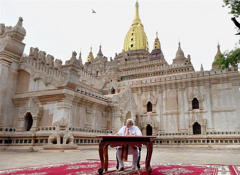 PM Narendra Modi signs guest book at Shwedagon Pagoda in Yangon