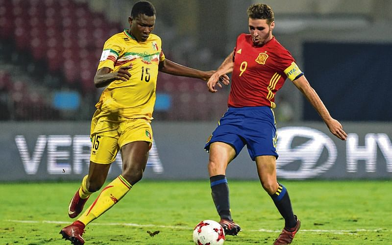 Ruiz strikes twice as Spain stop battling Mali to enter final