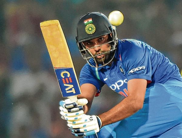 Indian cricketer Rohit Sharma plays a shot during the fifth one-day international cricket match against India at the Vidarbha Cricket Association Stadium in Nagpur on October 1, 2017. / AFP PHOTO / PUNIT PARANJPE / ----IMAGE RESTRICTED TO EDITORIAL USE - STRICTLY NO COMMERCIAL USE----- / GETTYOUT