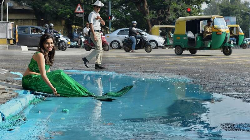 What an idea! To protest pothole deaths, Bengaluru artist converts one into mermaid's living space