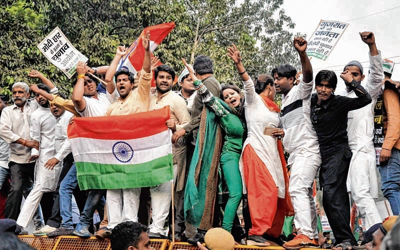 New Delhi: Delhi Pradesh Congress Committee activists shout slogans during a protest against BJP, and non- declaration of Gujarat Elections outside Election Commission of India in New Delhi on Monday. PTI Photo(PTI10_16_2017_000108B)