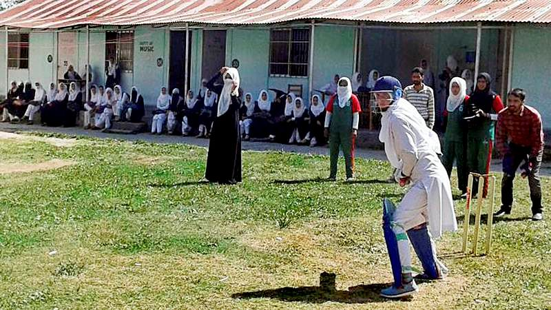 Nothing stops them. Woman cricketers in burqa and hijjab at Baramulla defying social restrictions in their passion for the sport. PTI Photo (STOTRY DEL18)