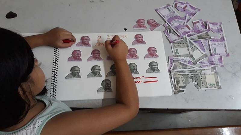 Gandhi Jayanti: Pic of girl cutting Mahatma's pictures from Rs 500, Rs 2000 notes goes viral