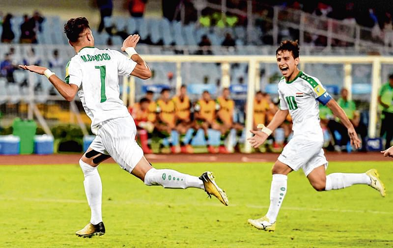 Iraq hold two-time champs Mexico for 1st ever draw