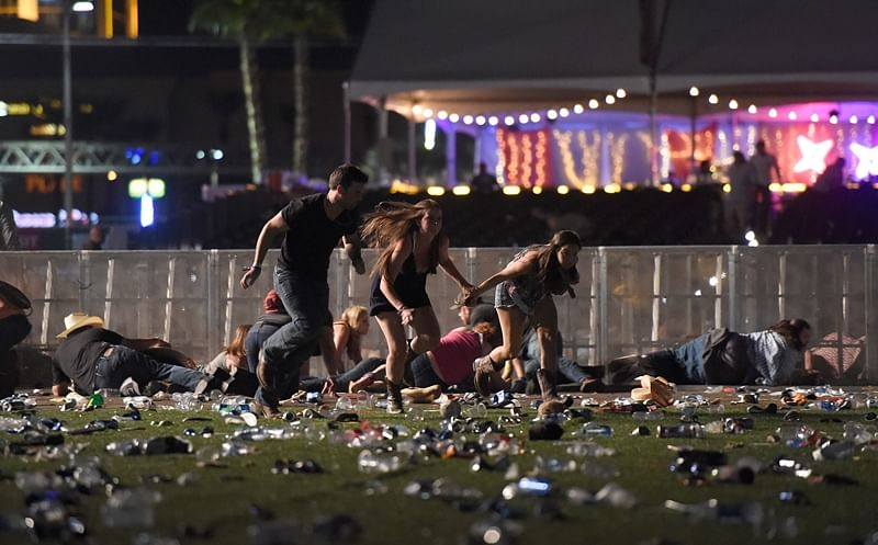 LAS VEGAS, NV - OCTOBER 01 People run from the Route 91 Harvest country music festival after apparent gun fire was heard on October 1, 2017 in Las Vegas, Nevada. There are reports of an active shooter around the Mandalay Bay Resort and Casino.   David Becker/Getty Images/AFP == FOR NEWSPAPERS, INTERNET, TELCOS & TELEVISION USE ONLY ==