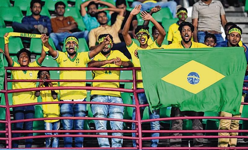 KOCHI, INDIA - OCTOBER 18:  Local Brazil fans celebrate at the end of the FIFA U-17 World Cup India 2017  Round of 16 match between Brazil and Honduras at the Jawaharlal Nehru International Stadium on October 18, 2017 in Kochi, India.  (Photo by Mike Hewitt - FIFA/FIFA via Getty Images)