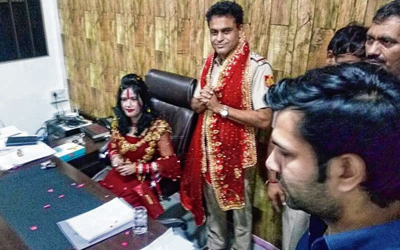 Plaint against Radhe Maa for sitting on SHO's chair