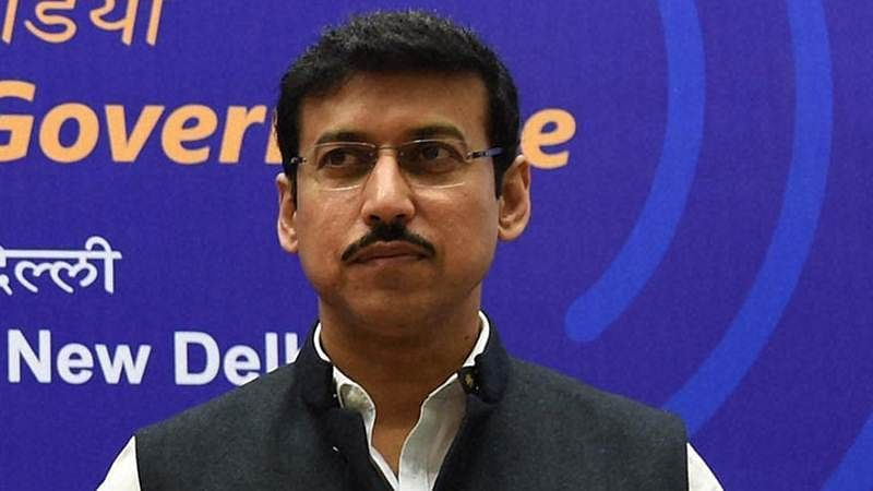Shooter Rajyavardhan Singh Rathore wants to hit bull's eye against champion Krishna Poonia, sans Narendra Modi wave