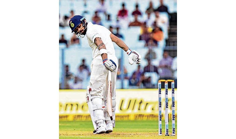 Kolkata: Indian cricket captain Virat Kohli reacts after his dismissal during the first day of the 1st cricket test match against Sri Lanka at Eden Gardens in Kolkata on Thursday. PTI Photo by Ashok Bhaumik     (PTI11_16_2017_000087B)