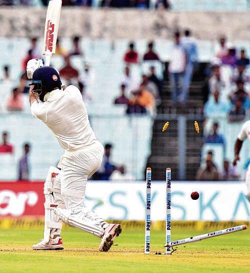 Kolkata: India;s Shikhar Dhawan is bowled out by Sri Lankan bowler Suranga Lakmal during first day of the 1st cricket test match at Eden Gardens in Kolkata on Thursday. PTI Photo by Ashok Bhaumik   (PTI11_16_2017_000058B)
