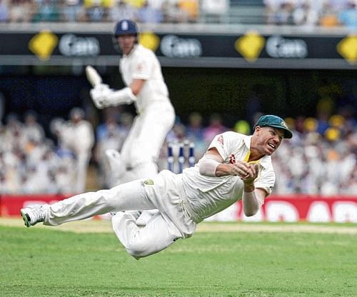 Brisbane: Australia's David Warner dives to catch the ball getting the wicket of England's Jake Ball during the Ashes cricket test between England and Australia in Brisbane, Australia, Friday, Nov. 24, 2017. AP/PTI(AP11_24_2017_000007B)