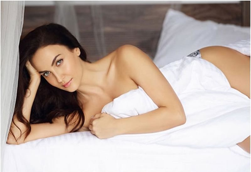 Hotness on bed! Elli Avrram heats it up in her latest photoshoot posing with just a bedsheet