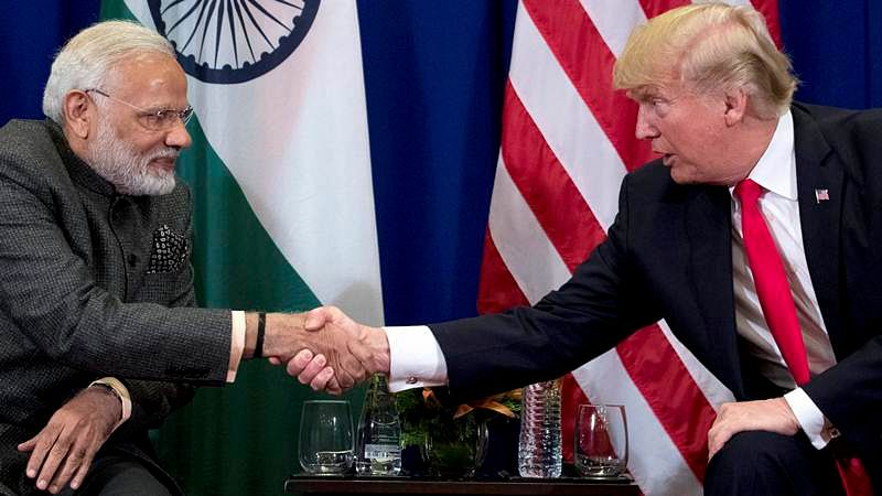 President Donald Trump, and Prime Minister Narendra Modi shake hands during a bilateral meeting at the ASEAN Summit at the Philippine. AP/PTI