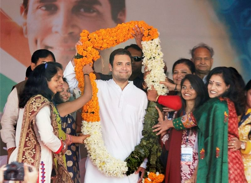 Ambaji: Supporters garlanded Congress vice president Rahul Gandhi during an interaction program with the IT cell at Ambaji in Gujarat on Sunday. PTI Photo   (PTI11_12_2017_000055B)