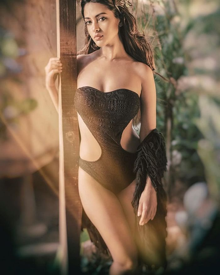 HOT! Riya Sen sizzles in this black swimsuit and she looks as sexy as ever