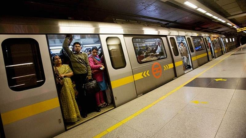 Delhi woman jumps on metro track to grab Rs 2,000 note, escapes unhurt