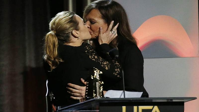 Kate Winslet kisses Allison Janney onstage at 2017 Hollywood Film Awards