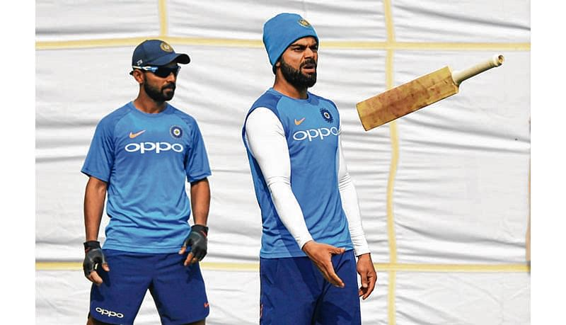 India's cricket captain Virat Kohli tosses a bat during a practice session ahead of the third Test match between India and Sri Lanka in New Delhi on December 1, 2017. / AFP PHOTO / -