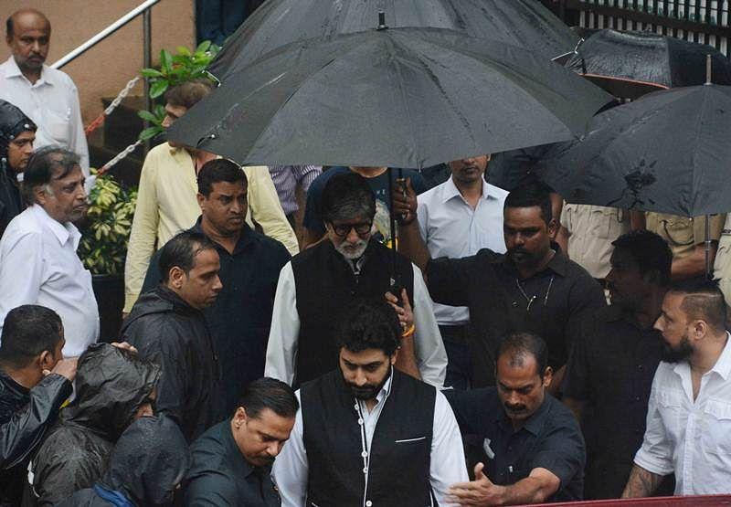 Amitabh Bachchan and Abhishek Bachchan at Shashi Kapoor's funeral at Santacruz Hindu crematorium in Mumbai. Pic by BL Soni