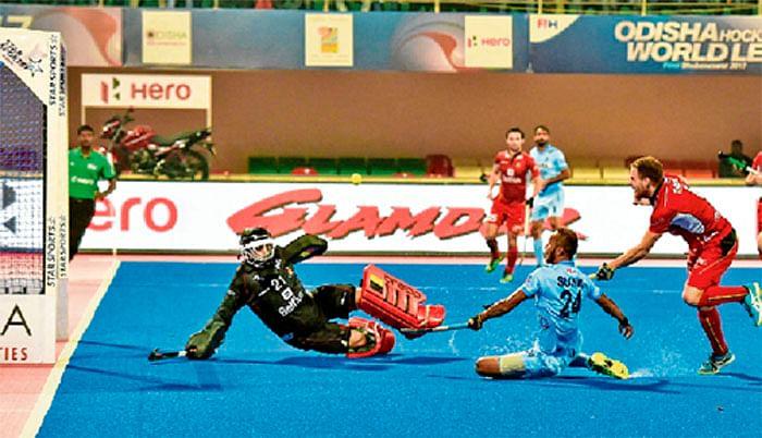 India stuns Belgium, into semis