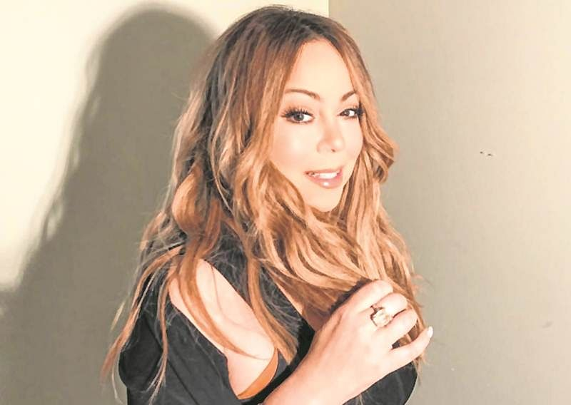 Mariah Carey's bodyguard accused of punching fan