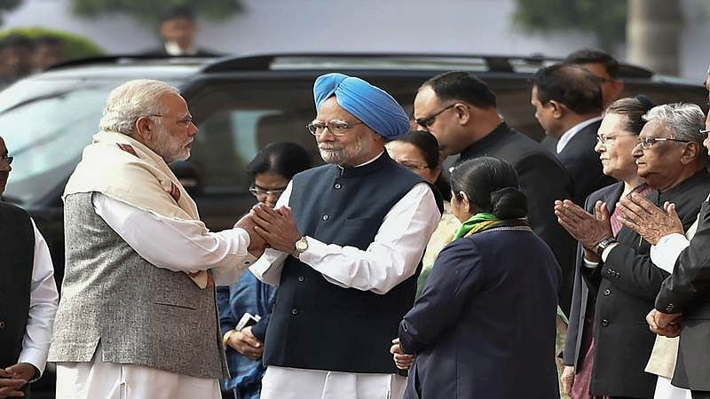 Manmohan Singh holds hands, then throws a punch at PM Modi