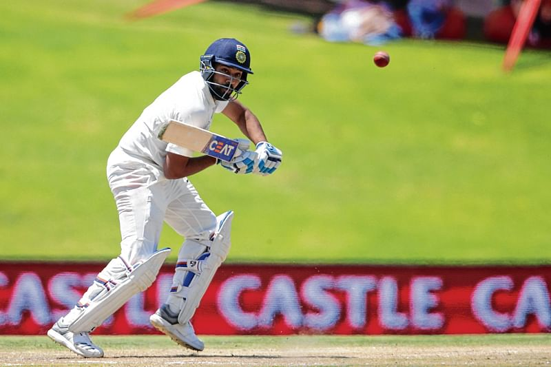 India's Rohit Sharma plays a shot during the fifth day of the second Test cricket match between South Africa and India at Supersport cricket ground on January 17, 2018 in Centurion, South Africa.  / AFP PHOTO / GIANLUIGI GUERCIA