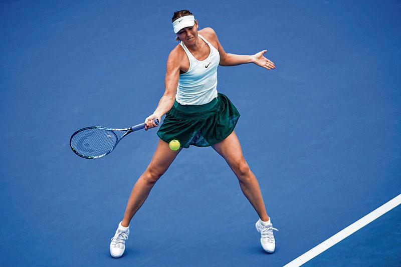 Sharapova struggles past Riske
