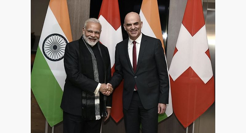 """This handout photo taken on January 22, 2018 and released by the Indian Press Information Bureau (PIB) shows Indian Prime Minister Narendra Modi (L) meeting with Swiss President Alain Berset. Indian Prime Minister Narendra Modi is to deliver the first keynote speech of the WEF in the Swiss resort, bookending a week that will climax in an address by US President Donald Trump, a year after he took office on a populist platform that demonised the globalist Davos crowd. / AFP PHOTO / PIB / - / RESTRICTED TO EDITORIAL USE - MANDATORY CREDIT """"AFP PHOTO / PIB"""" - NO MARKETING NO ADVERTISING CAMPAIGNS - DISTRIBUTED AS A SERVICE TO CLIENTS -"""