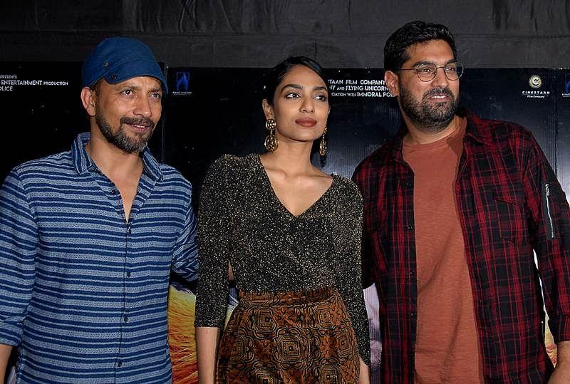 Indian Bollywood actors Deepak Dobriyal (L), Sobhita Dhulipala (C) and Kunaal Roy Kapur (R) attend the special screening of upcoming comedy Hindi film 'Kaalakaandi' in Mumbai on January 9, 2018. / AFP PHOTO / Sujit Jaiswal