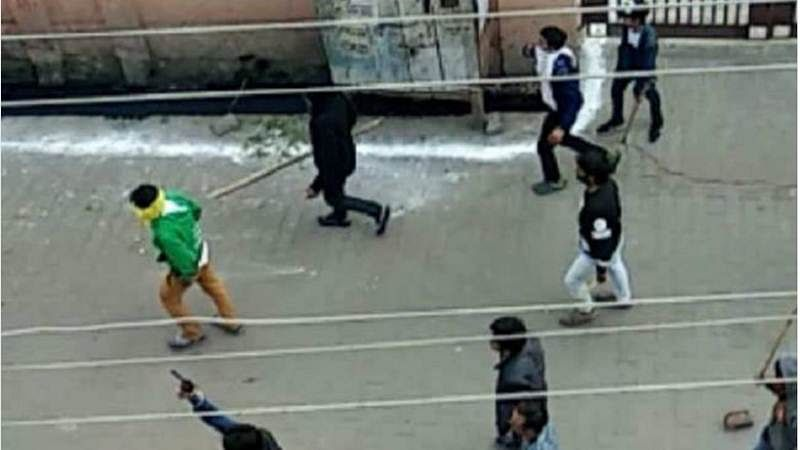 Kasganj violence: Viral video shows group of men on road with guns, clubs and sticks