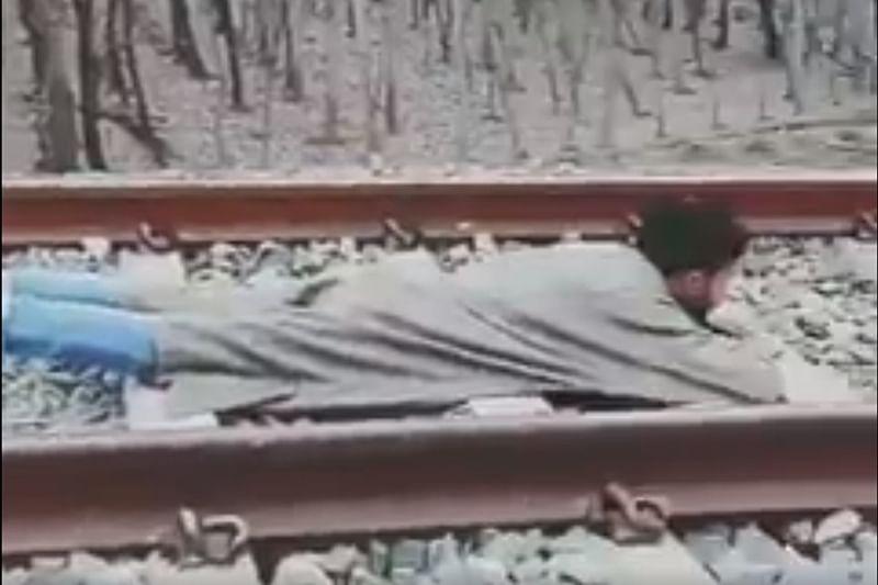 Viral Video: Kashmiri man lies on railway track as speeding train passes over him
