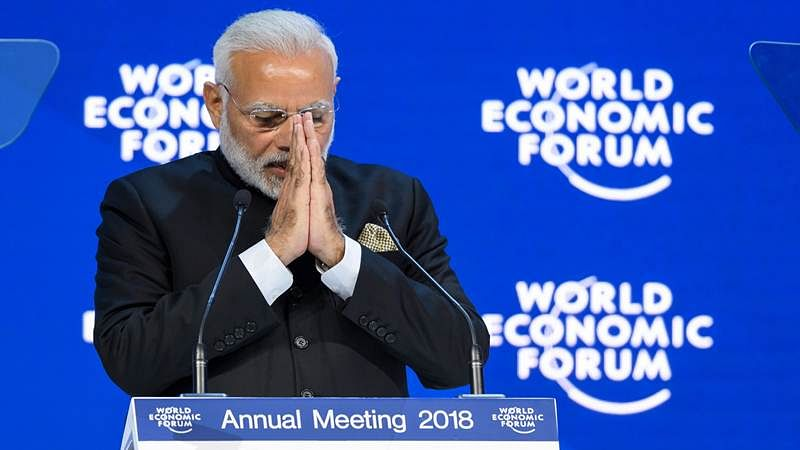 pm Narendra Modi gestures as he delivers his speech at the opening day the WEF. / AFP PHOTO / Fabrice COFFRINI