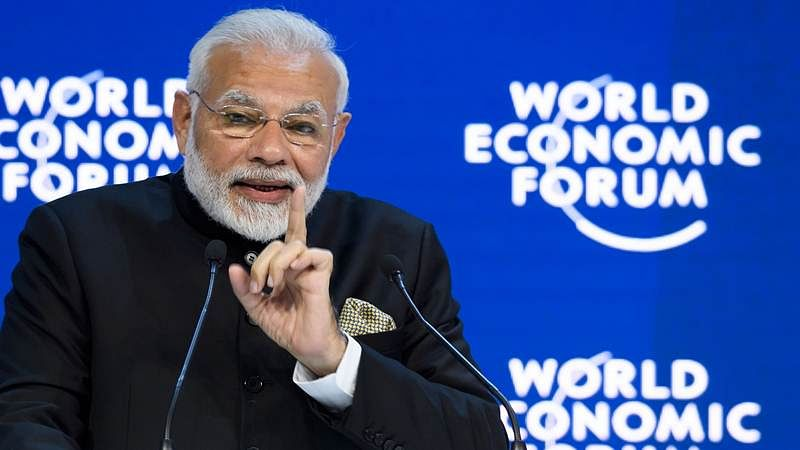 PM Narendra Modi delivers a speech on the opening day of the World Economic Forum. / AFP PHOTO / Fabrice COFFRINI