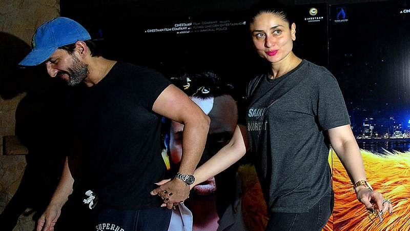 Indian Bollywood actors Saif Ali Khan with his wife Kareena Kapoor attend the special screening of upcoming comedy Hindi film 'Kaalakaandi' in Mumbai on January 9, 2018. / AFP PHOTO / Sujit Jaiswal
