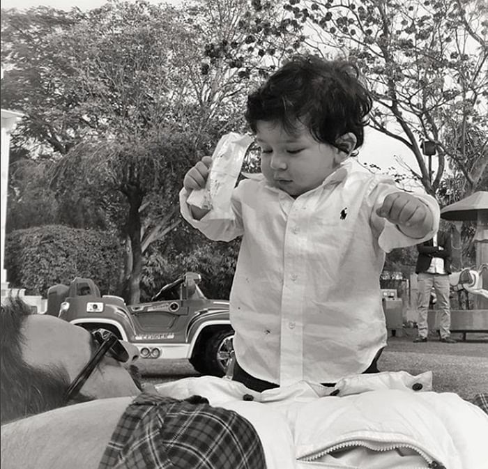 In Pictures: Taimur is up for some mischief with dad Saif Ali Khan