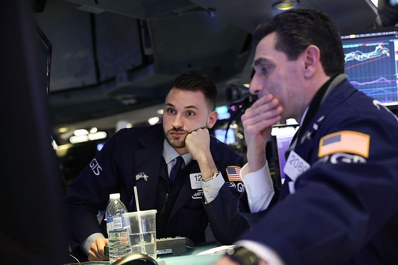 US stocks fell after the Federal Reserve raised its benchmark interest rate for the fourth time this year